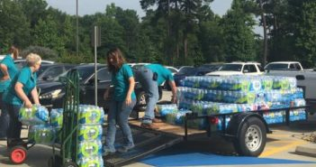 Red River Credit Union Employees and Members Make Large Water Donation to Shelter